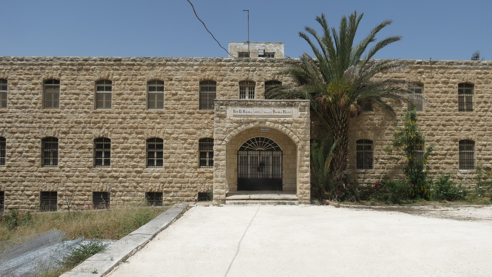 Part of the old hospital that the settlers bought near El-Aroub refugee camp