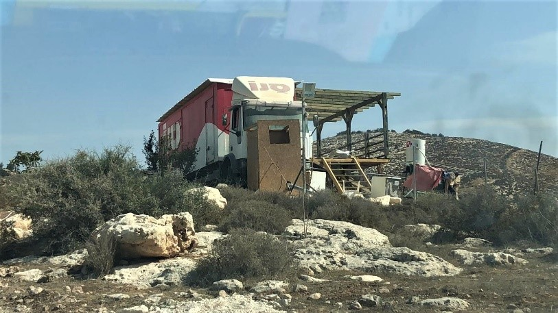 A truck converted into permanent living quarters in Negohot Farm outpost, 24 October 2018